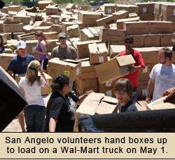 Volunteers in San Angelo load boxes on a Wal-Mart Truck
