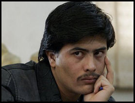 Parwez Kambakhsh listens to allegations against him at his trial in Kabul, Afghanistan, on Tuesday.
