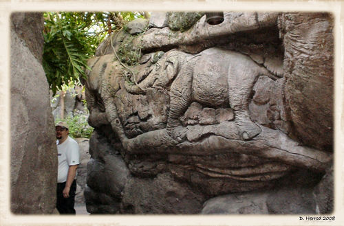 The Big Guy hiding among the animal carvings at the base of the Tree of Life