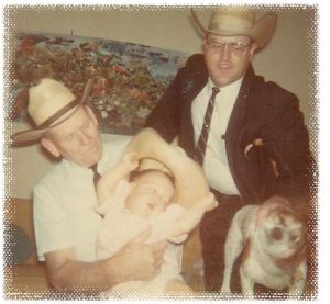 My Granddady is holding me. Polly is in front of my Daddy.