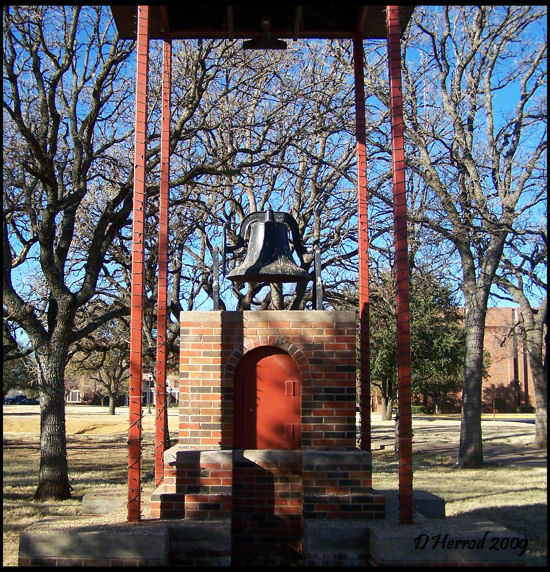Bell that once hung in the Old Main building. Today is displayed near the pond.