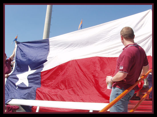 Displaying a very large Lone Star (Texas) flag.