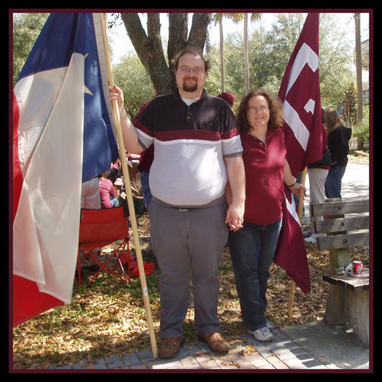 The Big Guy and I flanked by the Texas & A&M flags.